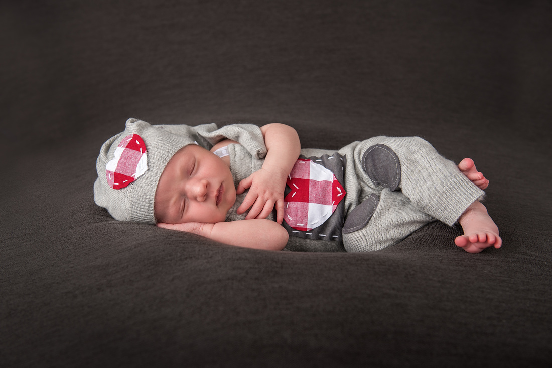 Newborn baby girl in grey hearts outfit